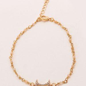 Bracelet laiton doré avec perles roses pales et symboles lune avec strass