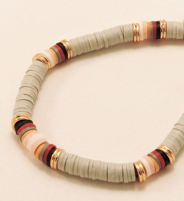 Bracelet réglable en perles de gommes grises, dorées